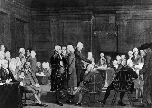Members of the Second Continental Congress prepare documentation for the Declaration of Independence in the Assembly Room of the Pennsylvania State House, Philadelphia, Pennsylvania, July 2, 1776. (Engraving Hulton Archive/Getty Images)